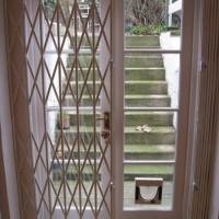 Half open collapsible door security grille