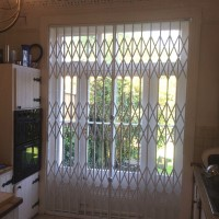 Collapsible security grille on a back door, fully closed