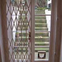 Collapsible door security grille - half closed