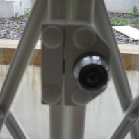 Tubular cam lock on a high security collapsible grille