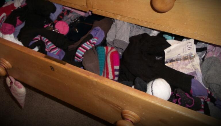Keys and cash hidden in a sock drawer